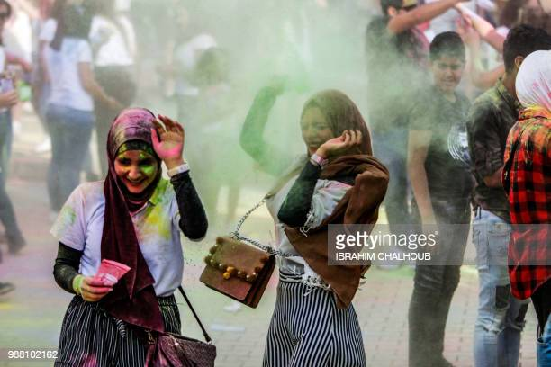Lebanese youths participate in a colour festival at City University in the Muslim district of Abu Samra in the northern port city of Tripoli on June...