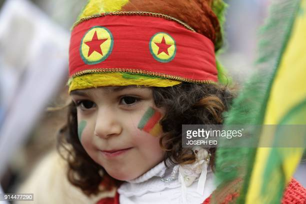 A LebaneseKurdish girl wears a head band bearing the colours of the Kurdistan Workers' Party during a demonstration in front of the US embassy in...