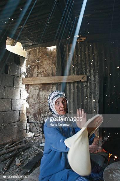 Lebanon, Beirut, Mature woman making bread