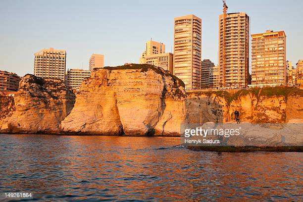 Lebanon, Beirut, Pigeon Rock and Beirut architecture at sunset