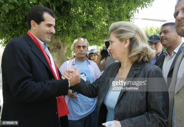 Greek Orthodox Gebran Tueini salutes Solange Gemayel widow of slain president and Christian warlord Beshir Gemayel at a pooling station in Beirut 29...