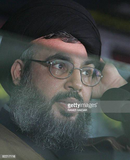 Hassan Nasrallah the secretary general of Lebanon's militant Shiite Muslim group Hezbollah addresses from behind a screen of bullitproof glass tens...