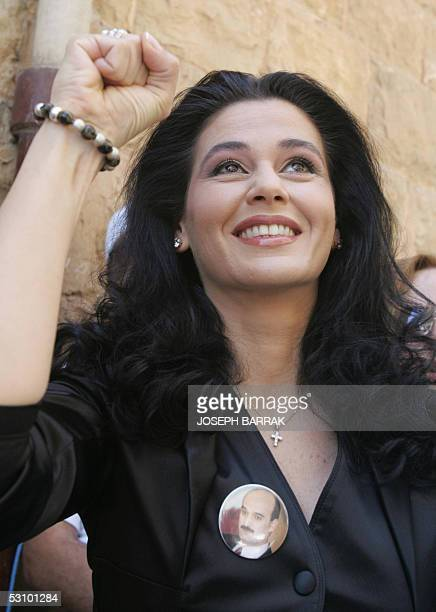 Lebanese Forces parliamentary candidate Sethrida Geagea wife of jailed former Christina warlord Samir Geagea clenches her fist after voting in the...