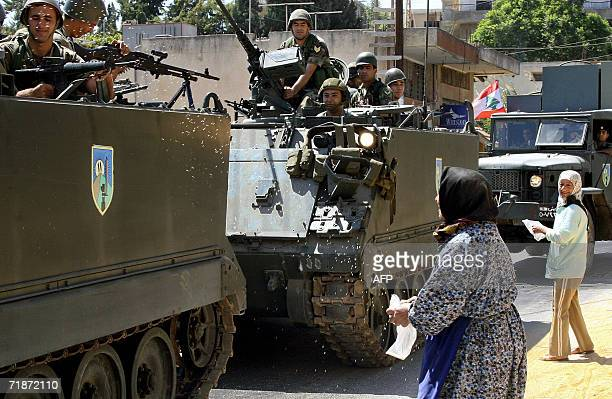 Lebanese women throw rice at Lebanese soldiers as they arrive to deploy in the southern village of Houla as a part of UN Security Council Resolution...
