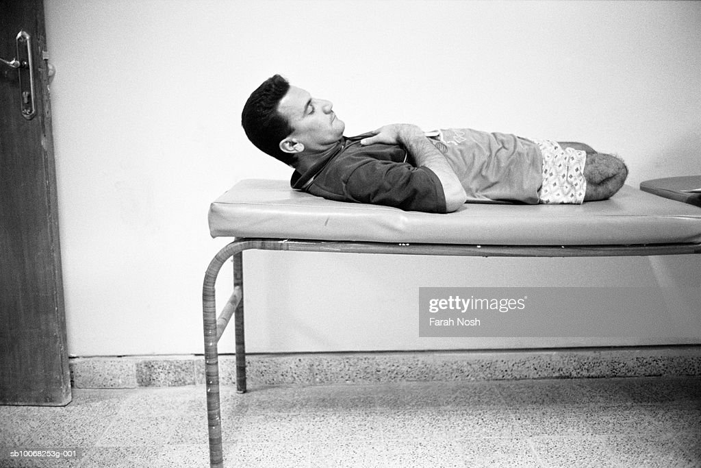 Amputee lying on hospital bed