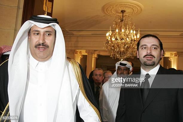 Qatari Foreign Minister Sheikh Hamad bin Jassem al-Thani is welcomed by the son of Lebanon's slain former prime minister Rafiq Hariri, Saadeddin ,...