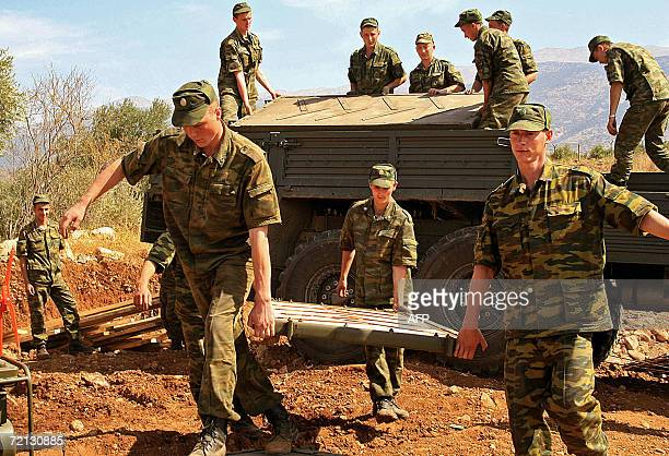 Russian soldiers carry construction matrial as the prepare to rebuild Ain Arab Bridge in south Lebanon 09 October 2006 Russian soldiers deployed in...