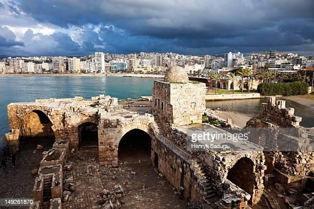 lebanon, sidon, sidon sea castle with city panorama - lebanon stock photos and pictures