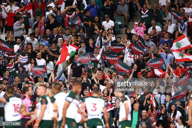 Lebanon supporters in the crowd cheer during the 2017 Rugby League World Cup match between Australia and Lebanon at Allianz Stadium on November 11...