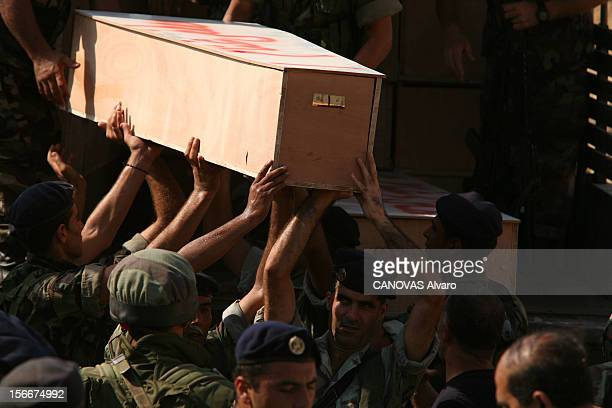 Lebanon The Bloody Road To Exodus Les obsèques de 80 victimes des bombardements israéliens à TYR un par un les cercueils non réclamés sont évacués...