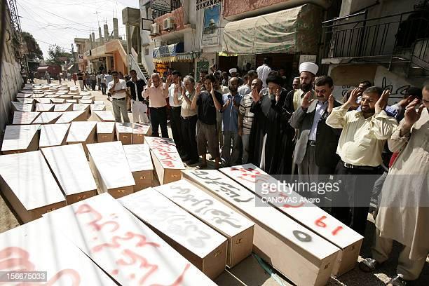 Lebanon The Bloody Road To Exodus Les obsèques de 80 victimes des bombardements israéliens à TYR au beau milieu de la rue qui longe l'hôpital un imam...