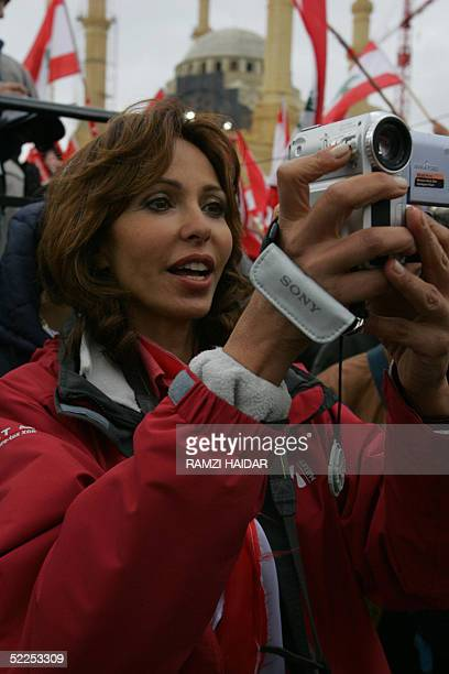 The wife of Lebanese Druze opposition leader Walid Jumblatt Noura films during an antiSyria rally in downtown Beirut in the early hours 28 February...