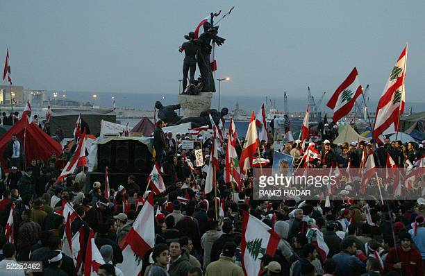 Thousands of demonstrators waving national flags and shouting antiSyria slogans rally around central Beirut's landmark Martyrs Statue early 28...