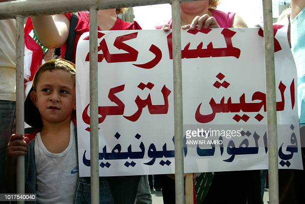 A Lebanon's Armenian boy stand near a banner denouncing Turkey take part in a demonstration in Beirut 08 September 2006 Armenians who have not...