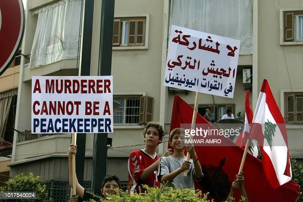 A Lebanon's Armenian boys carry banners denouncing Turkey take part in a demonstration in Beirut 08 September 2006 Armenians who have not forgotten...