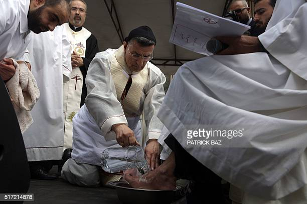 Lebanon's Cardinal Mar Bechara Boutros alRai the Maronite Patriarch of Antioch and the Whole Levant washes prisoners feet as part of the traditional...