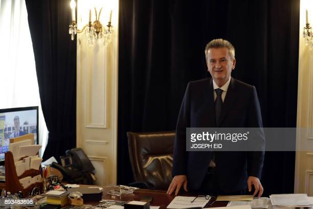 Lebanon's Central Bank Governor Riad Salameh speaks to a reporter during an interview with AFP at his office in Beirut on December 15 2017 Lebanon's...