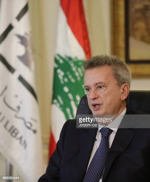 Lebanon's Central Bank Governor Riad Salameh speaks to a reporter during an interview with AFP at his office in Beirut on December 15 2017 / AFP...