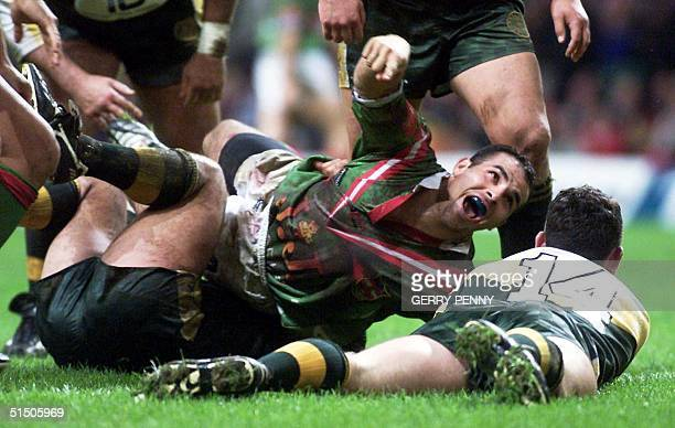 Lebanon's centre Hazem elMasri celebrates after scoring a try 05 November 2000 during the Rugby League group 2 World Cup match against Cook Islands...