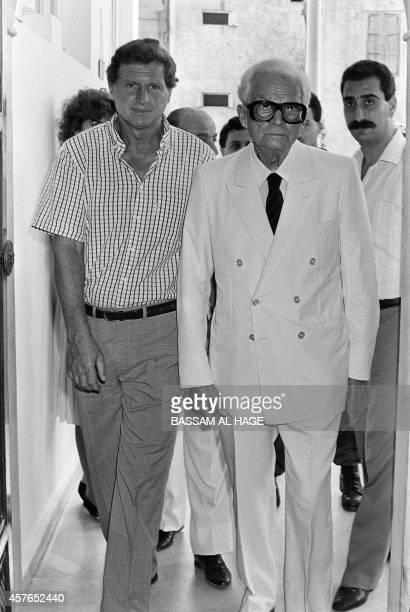 Lebanon's Christian Maronite Kataeb party leader and former Lebanese president Camille Chamoun and his son Dany Chamoun enter 26 August 1986 a Kataeb...