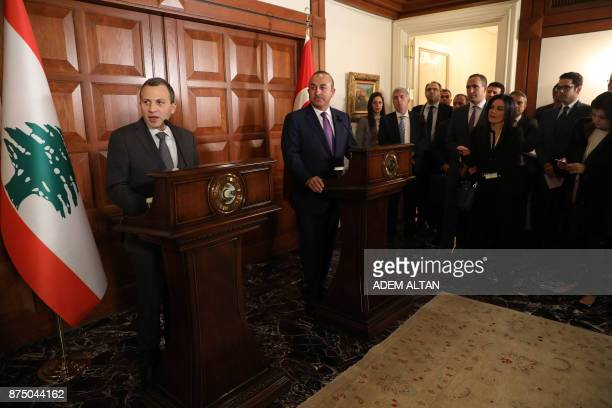 Lebanon's Foreign Minister Gebran Bassil is watched by his Turkish counterpart Mevlut Cavusoglu as he addresses a joint press conference following...