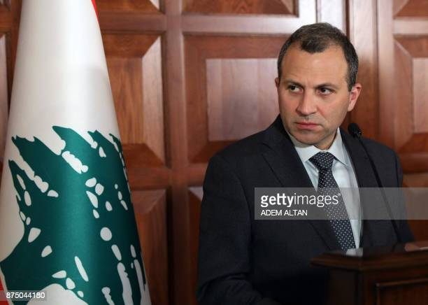 Lebanon's Foreign Minister Gebran Bassil looks on as he addresses a joint press conference with his Turkish counterpart Mevlut Cavusoglu following...