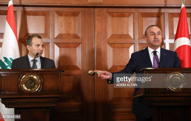 Lebanon's Foreign Minister Gebran Bassil looks on as his Turkish counterpart Mevlut Cavusoglu gestures while addressing a joint press conference...
