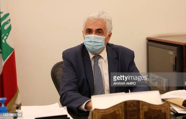 Lebanon's Foreign Minister Nassif Hitti is pictured wearing a face mask due to the coronavirus in his office in the capital Beirut, on August 3,...