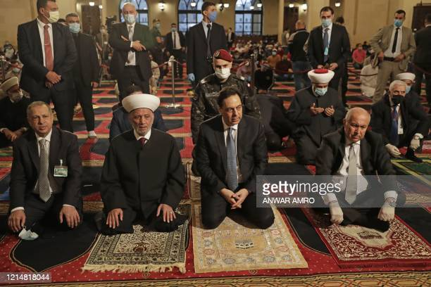 Lebanons Grand Mufti Sheikh Abdel-Latif Derian , Prime Minister Hassan Diab and MP Fouad Makhzoumi , take part in a morning prayer to celebrate the...