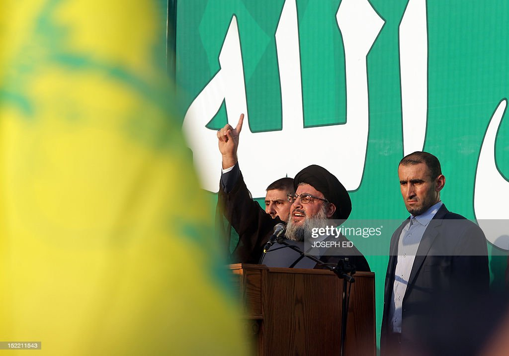 Lebanon's Hezbollah chief Hassan Nasrallah (C) addresses thousands of supporters who took to the streets of southern Beirut to denounce a film mocking Islam on September 17, 2012. Nasrallah, who made a rare public appearance, has called for a week of protests across the country over the low-budget, US-made film, describing it as the 'worst attack ever on Islam.'
