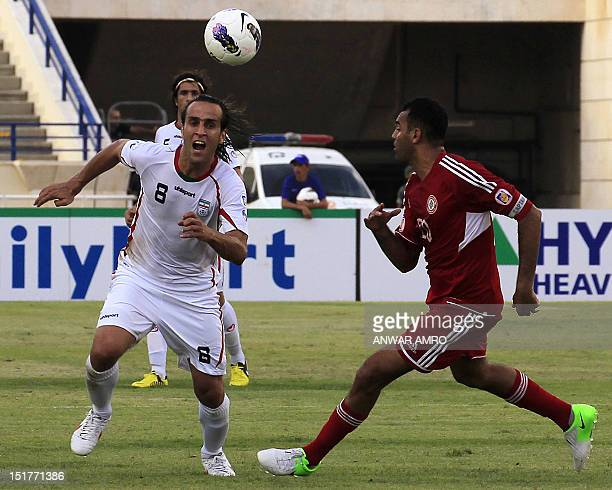 Lebanon's midfielder Roda Antar challenges Iran's striker Ali Karimi during their 2014 World Cup Asian zone group A qualifying football match at...