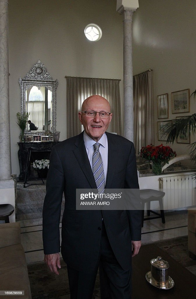 Lebanon's newly named Prime Minister Tammam Salam poses during an interview with AFP's journalists following his official appointment, on April 6, 2013 at his home in the Lebanese capital Beirut. Salam's appointment comes two weeks after Najib Mikati resigned and effectively brought down his Hezbollah-dominated government.