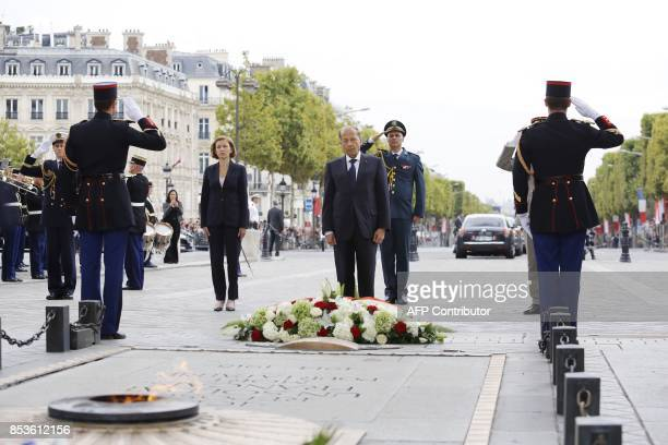 Lebanon's President General Michel Aoun and French Defence Minister Florence Parly stand in front of the flame of the Tomb of the Unknown Soldier...