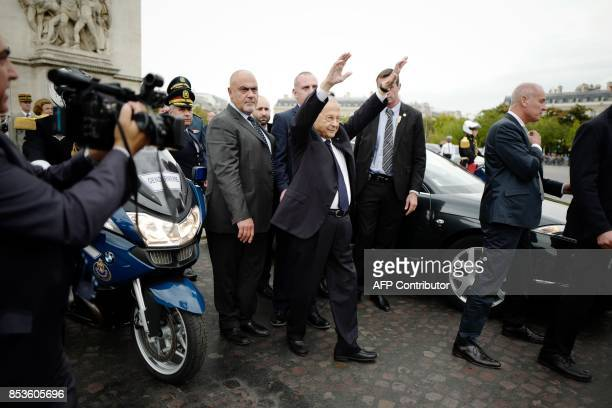 Lebanon's President General Michel Aoun gestures during a welcome ceremony under the Arc de Triomphe in Paris on September 25 2017 Lebanese President...