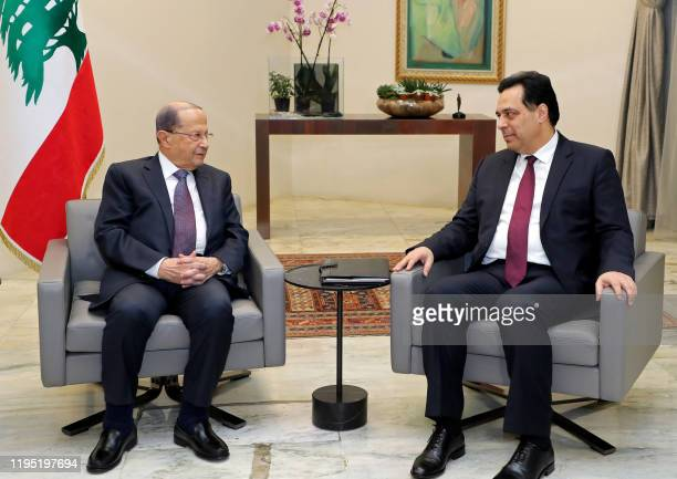 Lebanon's President Michel Aoun meets with prime minister designate Hassan Diab at the presidential palace in Baabda, east of the capital Beirut, on...