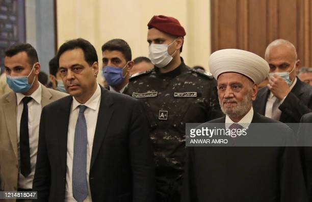 Lebanons Prime Minister Hassan Diab and Grand Mufti Sheikh Abdel-Latif Derian arrive for a morning prayer to celebrate the Eid al-Fitr holiday at...