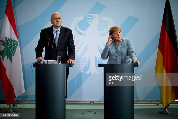 Lebanon's Prime Minister Najib Mikati and German Chancellor Angela Merkel address a press conference at the Chancellery on July 5 in Berlin. AFP...
