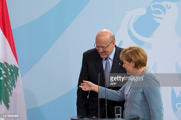Lebanon's Prime Minister Najib Mikati , and German Chancellor Angela Merkel react during a press conference at the Chancellery on July 5 in Berlin....