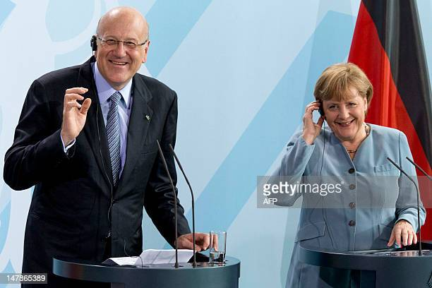 Lebanon's Prime Minister Najib Mikati and German Chancellor Angela Merkel smile during a press conference at the Chancellery on July 5 in Berlin. AFP...