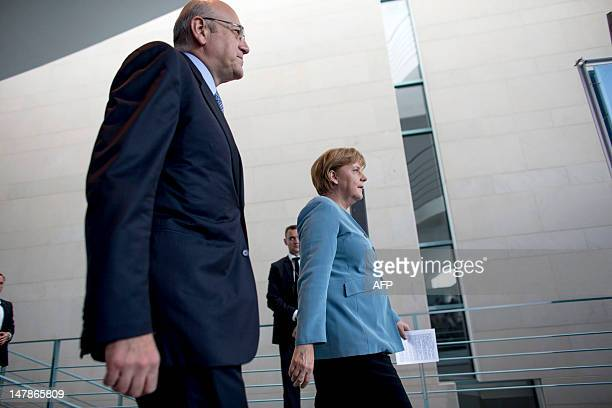Lebanon's Prime Minister Najib Mikati and German Chancellor Angela Merkel arrive for a press conference at the Chancellery on July 5 in Berlin. AFP...