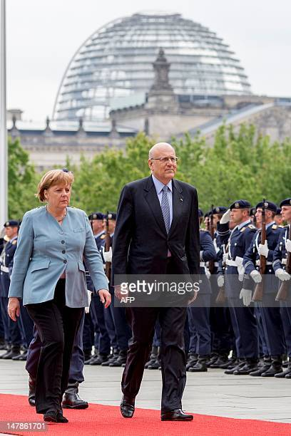 Lebanon's Prime Minister of the Republic of Lebanon, Najib Mikati and German Chancellor Angela Merkel review a guard of honour at the Chancellory on...