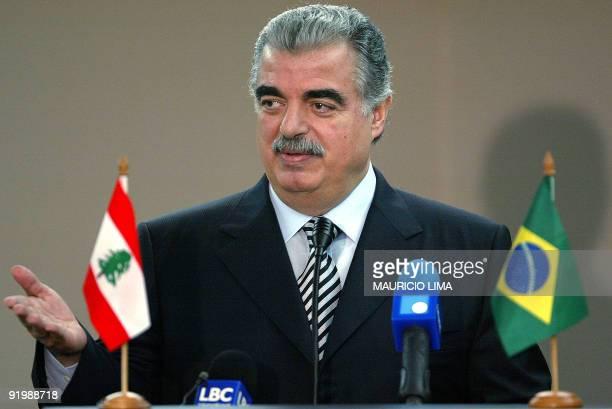 Lebanon's Prime Minister Rafik Hariri answer questions 09 June 2003 during a press conference in Sao Paulo Brazil Hariri's official visit to Brazil...