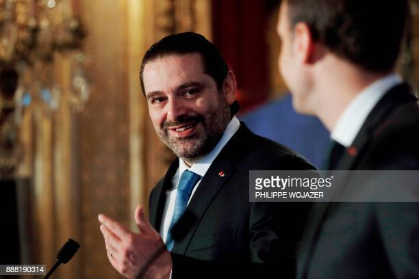 Lebanon's Prime Minister Saad Hariri and French President Emmanuel Macron attend the Lebanon International Support Group meeting in Paris on December...