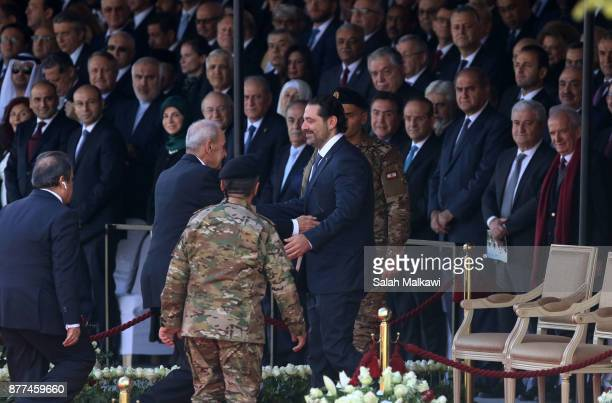 Lebanon's prime minister Saad Hariri is greeted by speaker of Lebanese parliament Nabih Berry prior to the Independence Day ceremony on November 22...