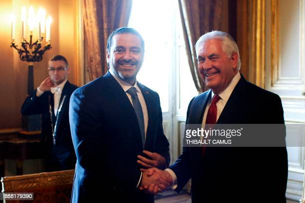 Lebanon's Prime Minister Saad Hariri shakes hands with US Secretary of State Rex Tillerson during a meeting in Paris on December 8 2017 Hariri meets...