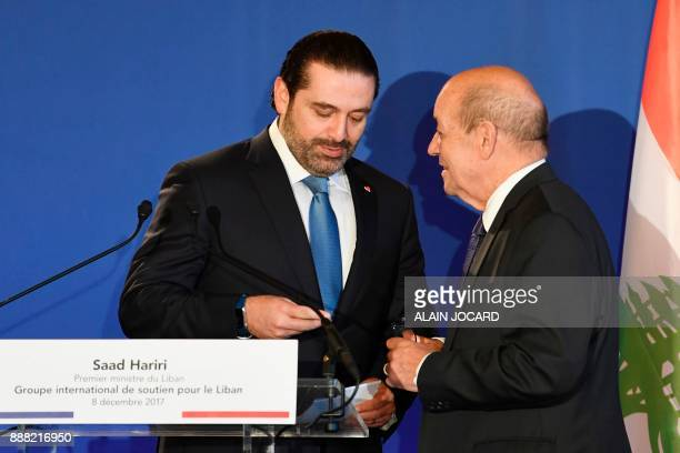 Lebanon's Prime Minister Saad Hariri speaks with French Minister for Europe and Foreign Affairs JeanYves Le Drian during the Lebanon International...