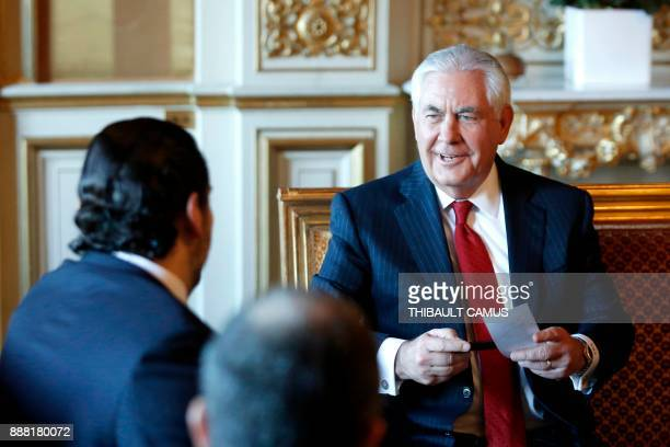 Lebanon's Prime Minister Saad Hariri speaks with US Secretary of State Rex Tillerson during a meeting in Paris on December 8 2017 Hariri meets with...