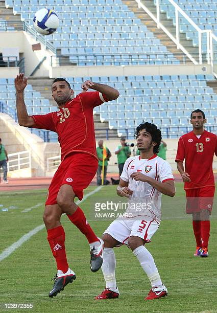 Lebanon's Roda Antar jumps to head the ball as he challenges Amer alHammadi during their 2014 World Cup Asia zone qualifying football match in Beirut...