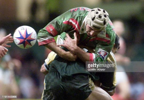 Lebanon's Second Row Joe Lichaa is lifted high by an unidentified Cook Island defender 05 November 2000, during their Rugby League group 2 World Cup...