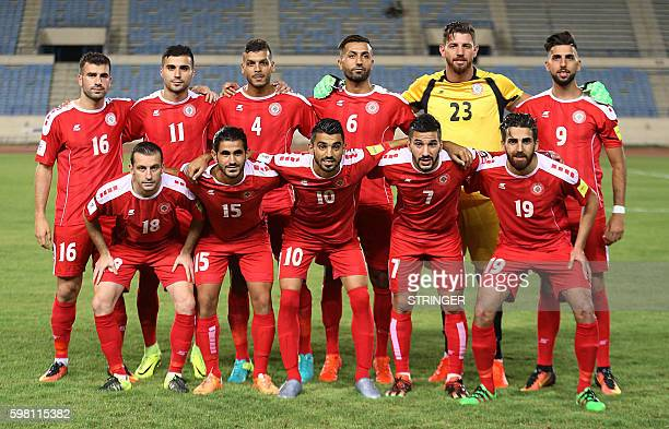 Lebanon's team poses for a picture ahead of the friendly football match between the Jordanian and Lebanese national football teams at Camille Shamoun...